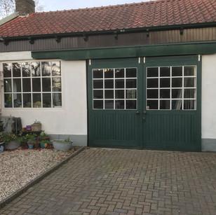 Oude garagedeur te vervangen