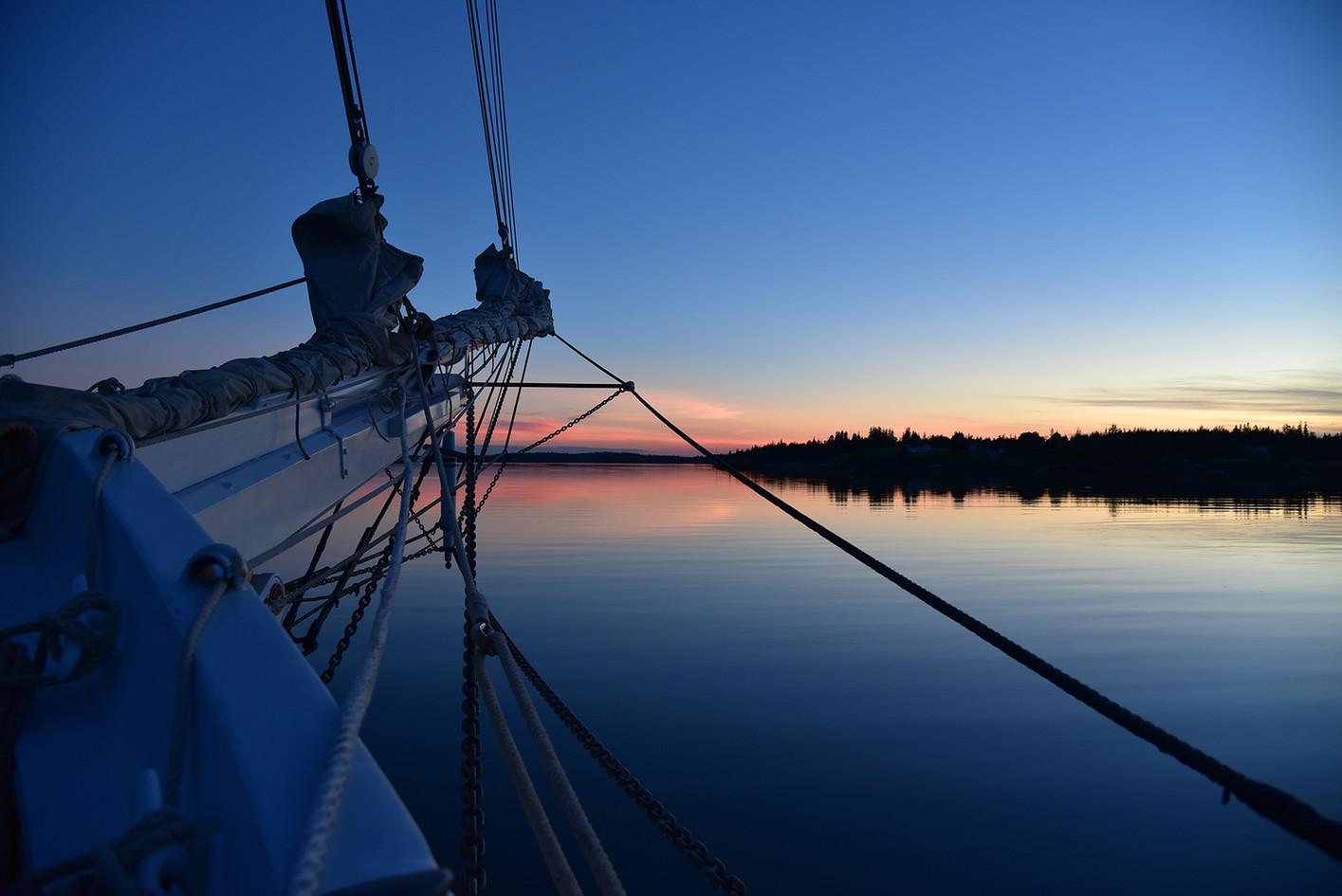 Sunrise over the bowsprit. Photo: Adam Huff