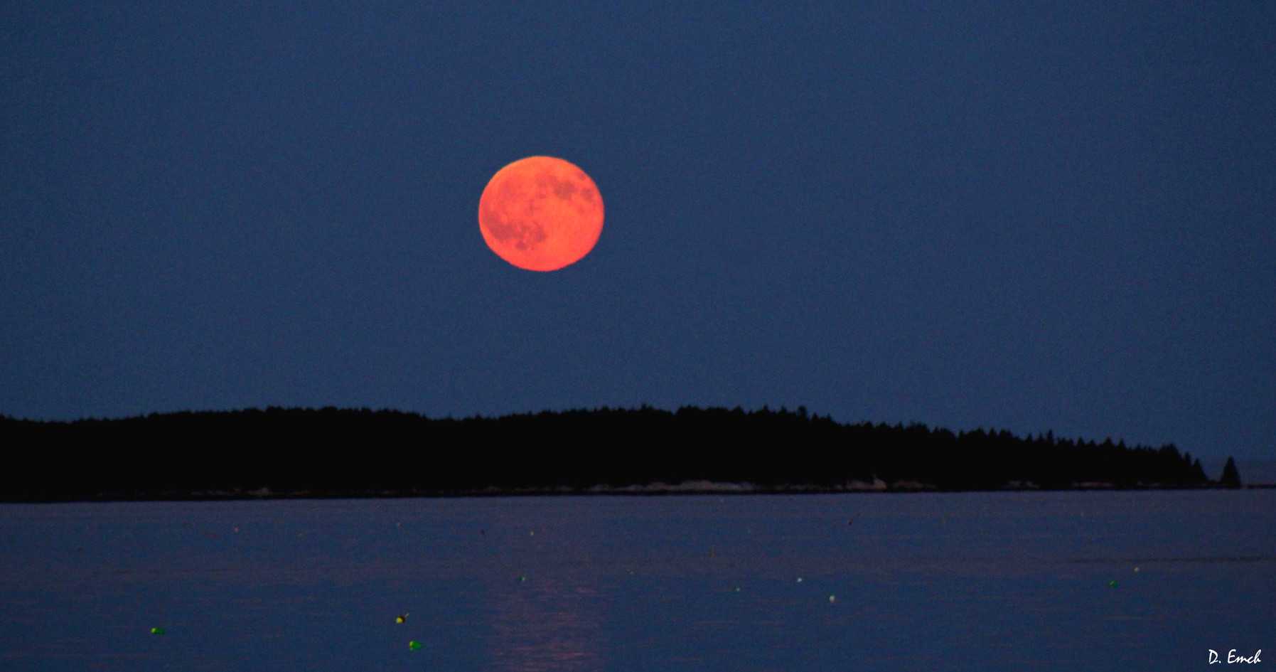 Moon rises over a quiet achorage. Photo: Dave Emch