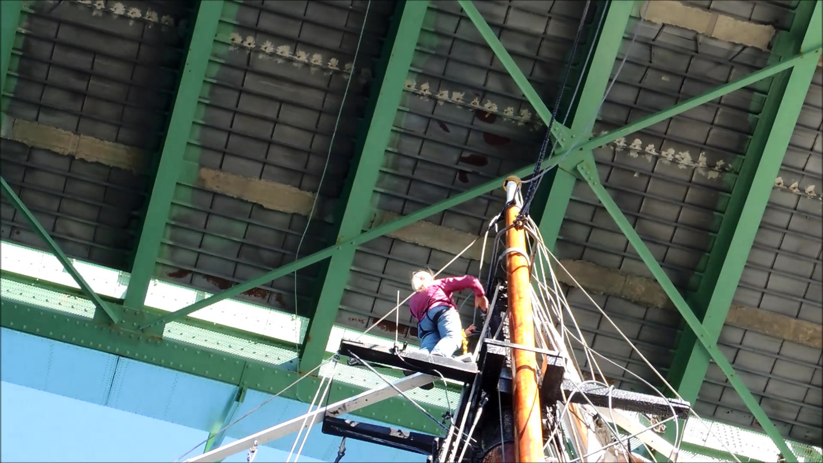 Sailors aloft! Sailing under the Deer Isle Bridge with topmasts lowered. Video: Dick Loehr