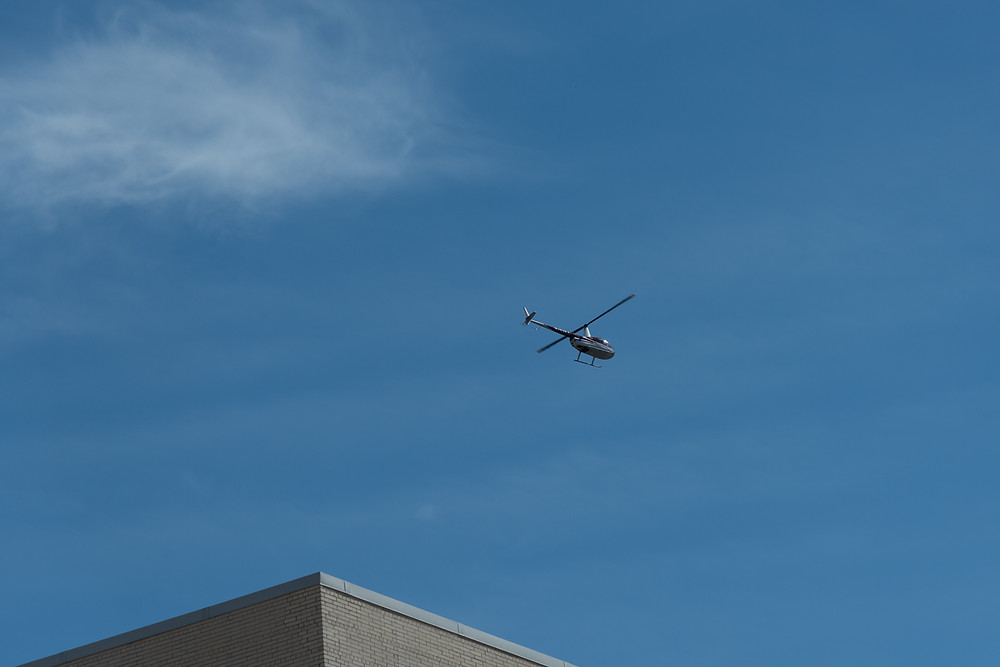 R44 on photography flight interrupts the heli expo helicopters from arriving