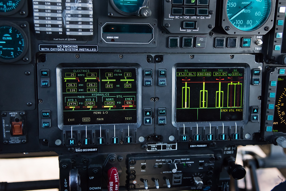 Agusta A109E cockpit with hydraulic caution message