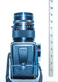 Hasselblad with 150mm lens is about 9.5 inches long