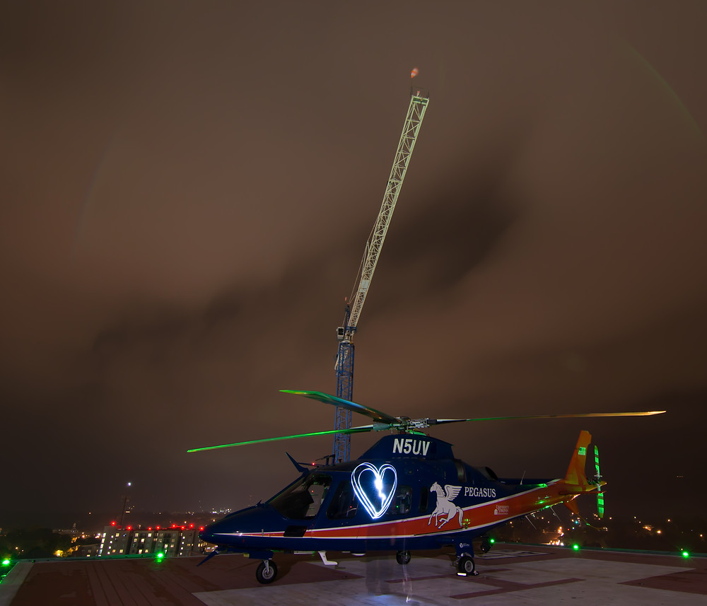 Pegasus helicopter with light painting heart