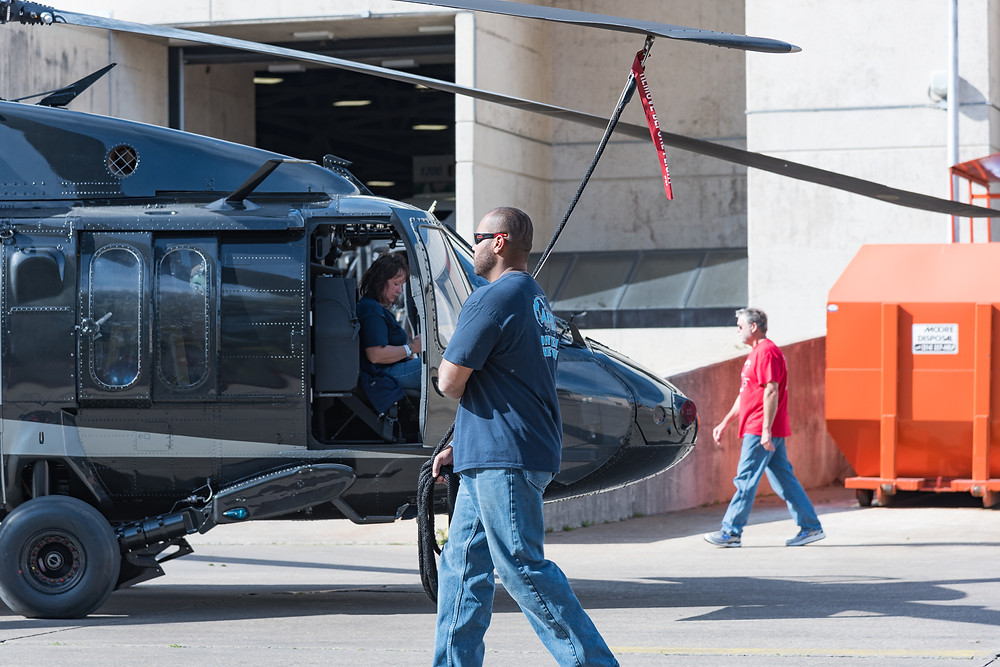 Sikorsky Blackhawk is towed into the Dallas convention center for heli expo 2017