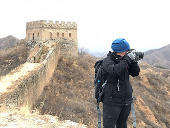 Erin Emery photographing the Great Wall of China with her Nikon d810