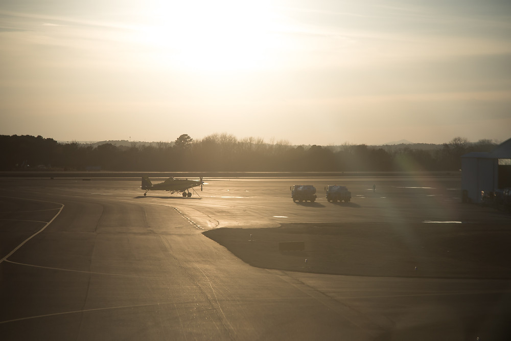Landing at Hot Spring Airport, a turbine Pawnee sits on the ramp in the setting sun
