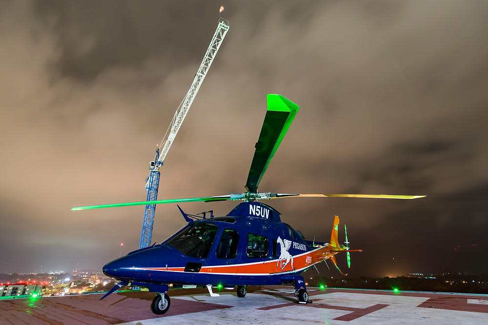 Pegasus helicopter on the UVA rooftop helipad and crane in the background