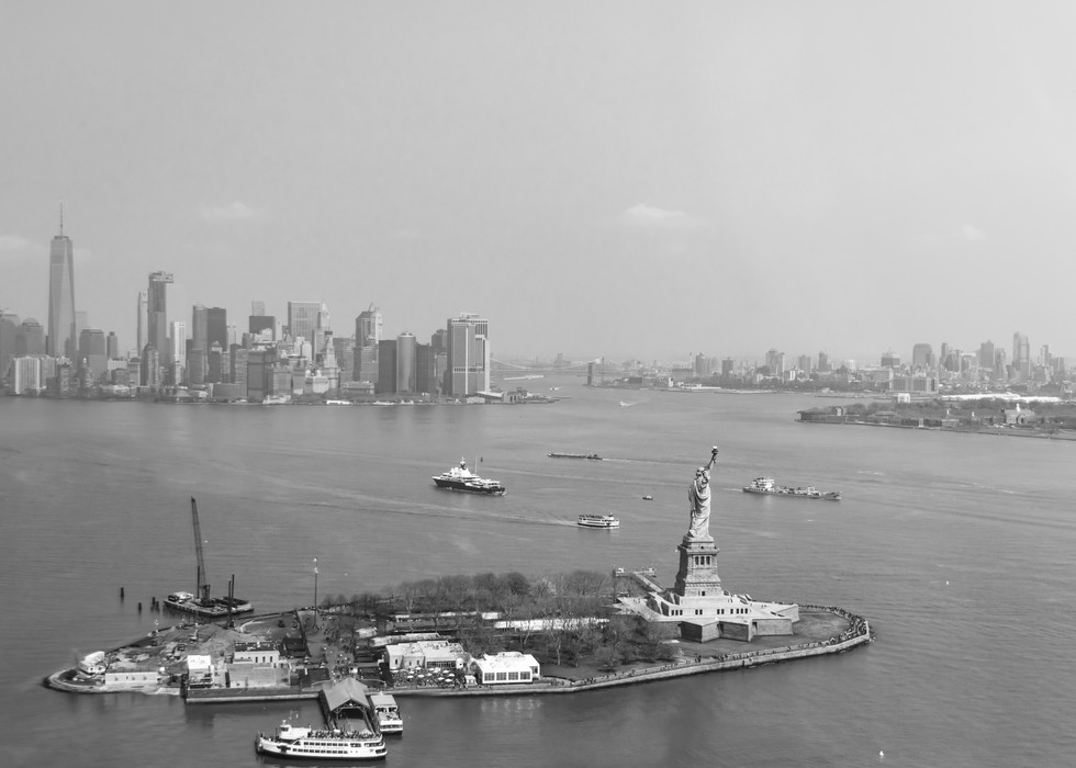 Lady Liberty overlooks the busy harbour