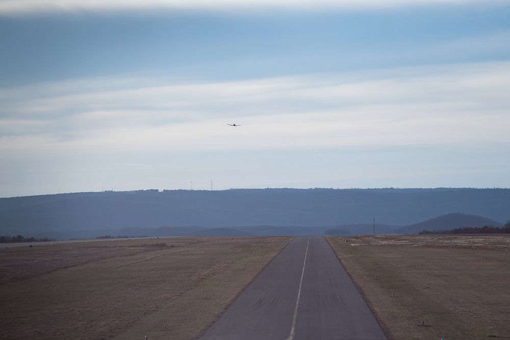 Departing small Arkansas airport behind a little single engine airplane