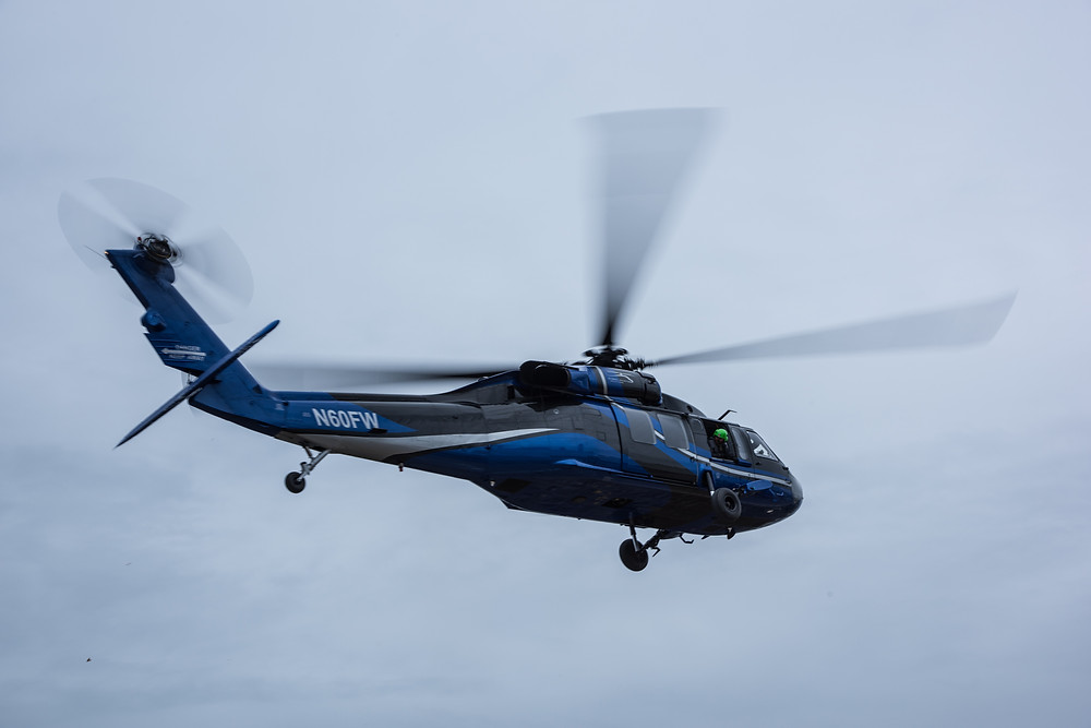 This Backhawk helicopter hovered above us, its downwash creating chaos on the loading dock at heli-expo