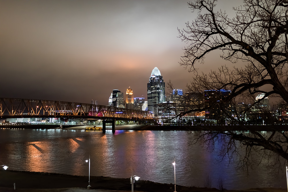 Cincinnati OH night skyline, from across the Ohio River at Newport on the Levee