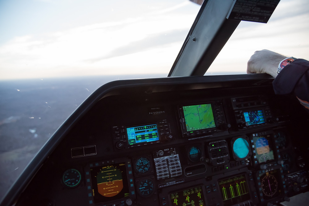 Cockpit of Agusta A109E helicopter, keeping an eye on the time and fuel