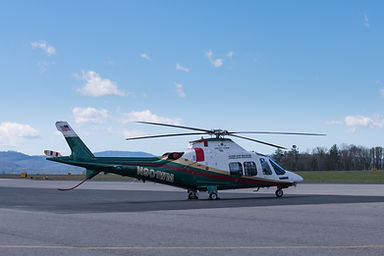 N901WM Agusta A109SP helicopter parked in Asheville NC with engine covers installed