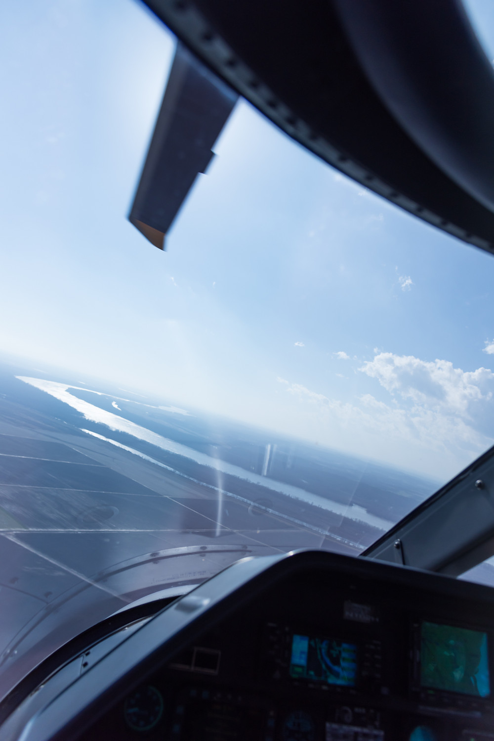 The Mississippi River from the cockpit of the Agusta A109E helicopter