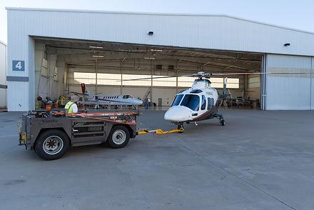 Signature Aviation at Love Field pushing N901WM into the SevenBar Aviation Hangar