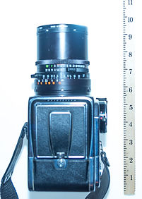 Hasselblad wih 50mm lens is about 9.5 inches long
