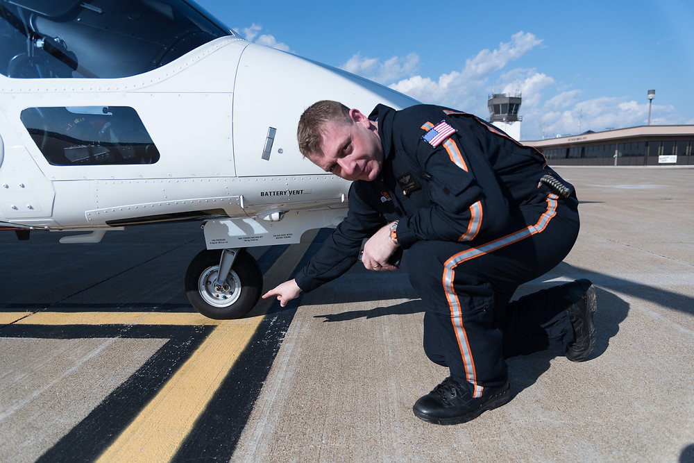 Stephen Boatwright impressed by his parking job of a A109E agusta helicopter