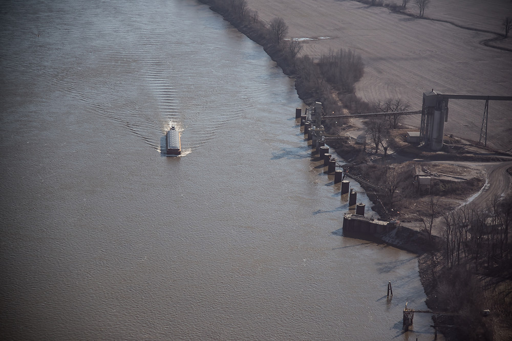 Barge on Mississippi River, Illinois Missouri state line, muddy waters