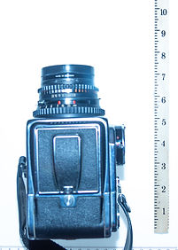 Hasselblad with 80mm lens is about 8 inches long