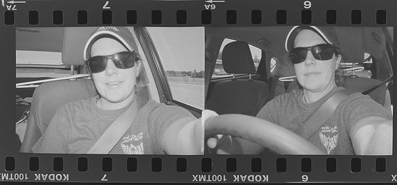 Film camera selfie on black and white Kodak 100TMAX
