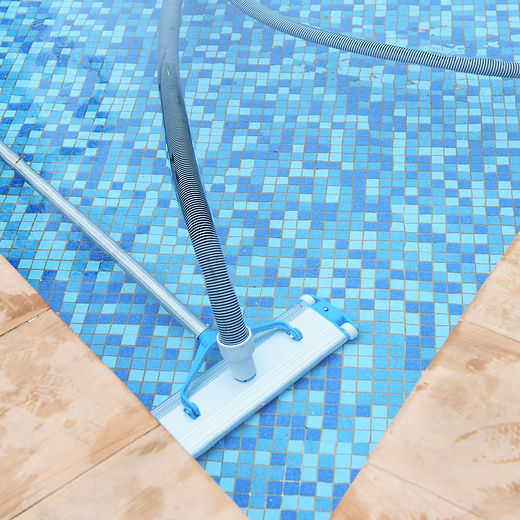 Swimming pool cleaning tools in the bottom.jpg