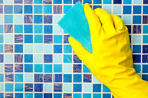 Hand in yellow protective glove cleaning