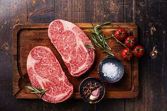 A picture of Oregon Country Steaks with rosemary, tomatoes & salt.