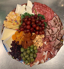 Large cheese tray with fresh fruit and nuts