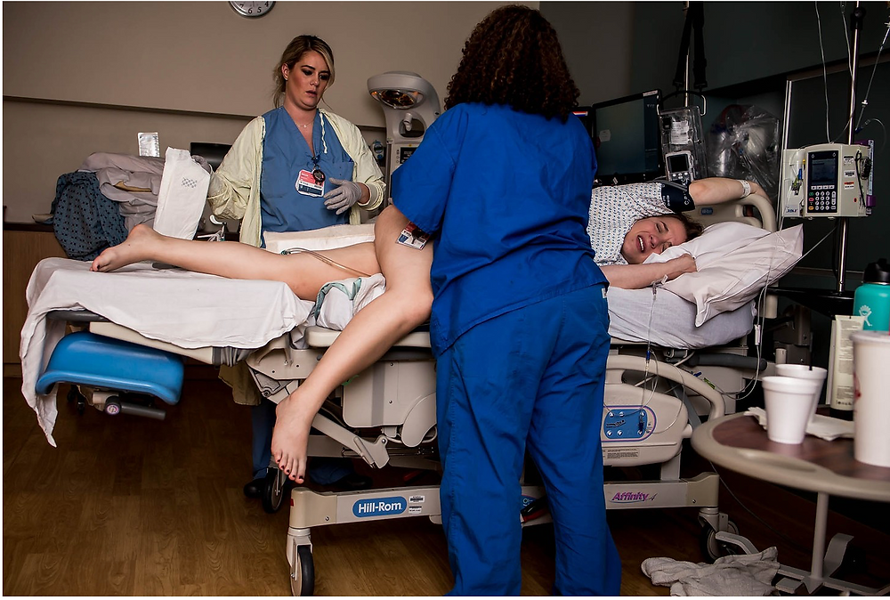 Nurses perform a side-lying release on laboring mother