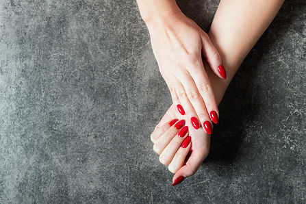 young-lady-is-showing-her-red-manicure-n