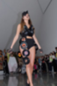 "Transformational avant-garde garment titled ""Rerun"" featured at the Transparency Pop-Up Fashion Show hosted by the Eli and Edythe Broad Art Museum constructed of Recycled Vinyl Records designed and constructed by Michigan State University Apparel and Textile Design Student Sara Stanzler aka The Golden Haired Girl"