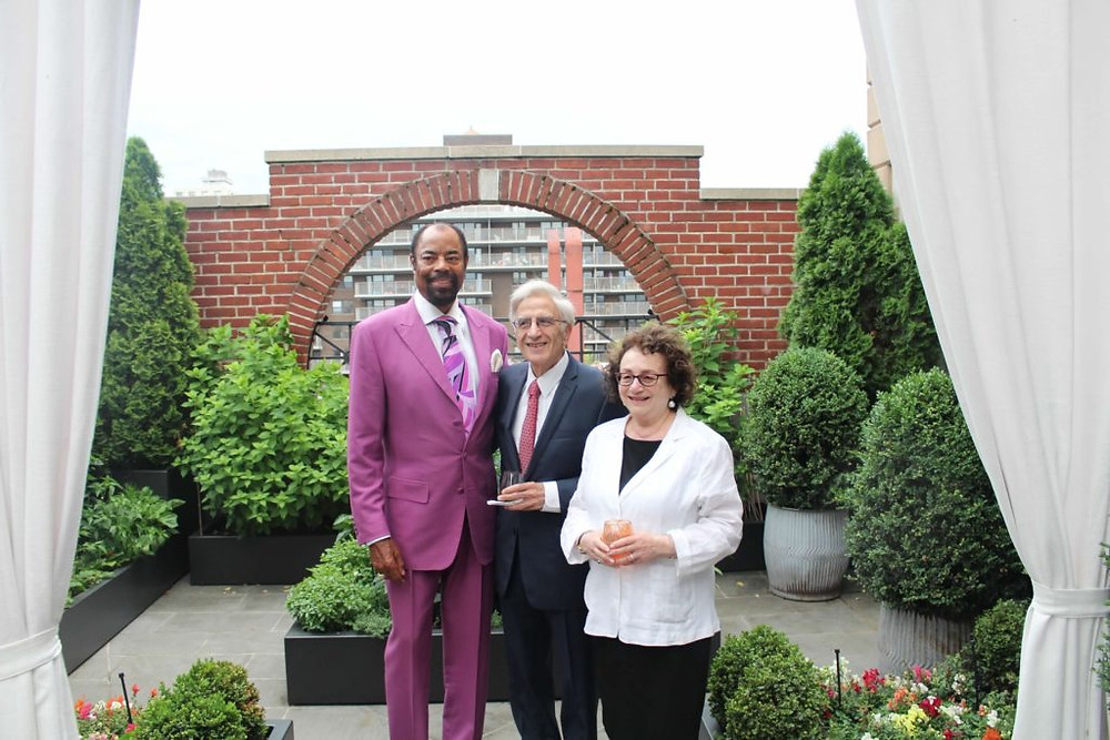 """Barry, his wife Barbara, and Walter """"Clyde"""" Frazier in 2019."""