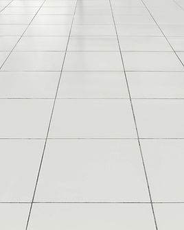 Sparkling clean white tiles and grout