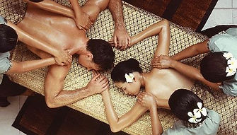 Four Hand Massage in Holborn, performed by two nubile, nude Masseuses.