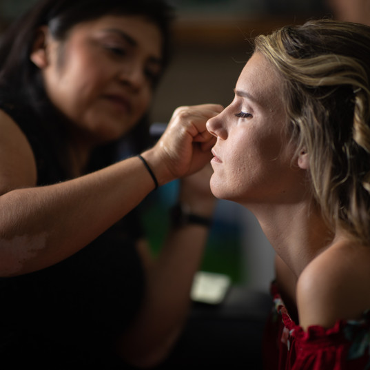 Brenda doing makeup on a bridesmaid