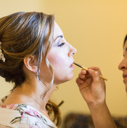 Brenda adding finishing touches to one of her brides