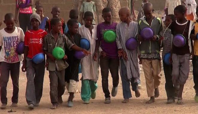 Some Almajiri children out on the street to beg for alms