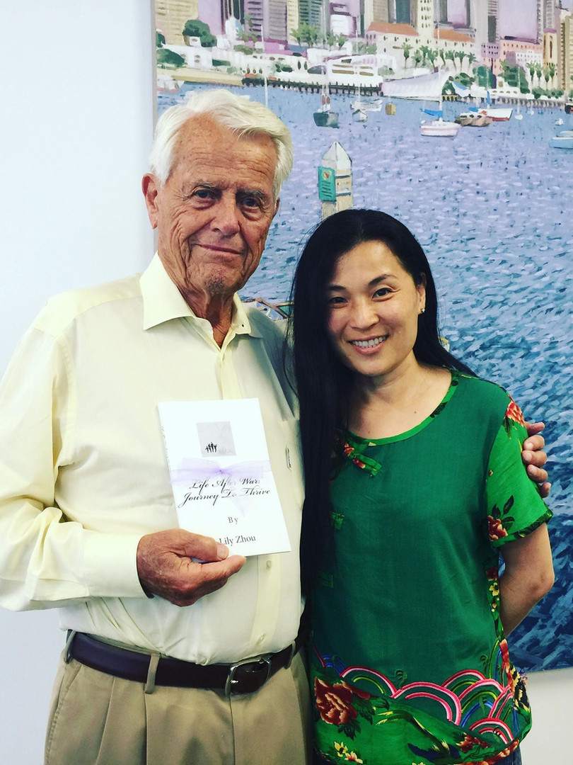 "KSO Founding Chairman Malin Burnham with Lily's book ""Life after War: Journey to Thrive"""