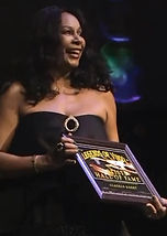 Claudja Barry With Award.jpg