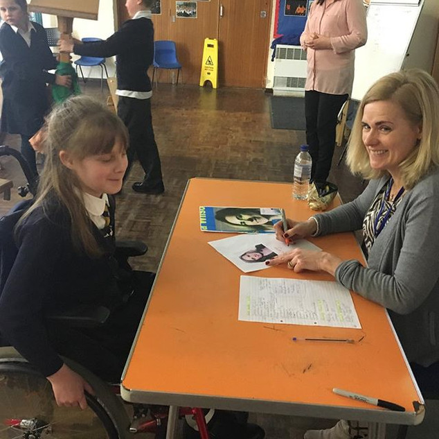 Meeting readers and signing books