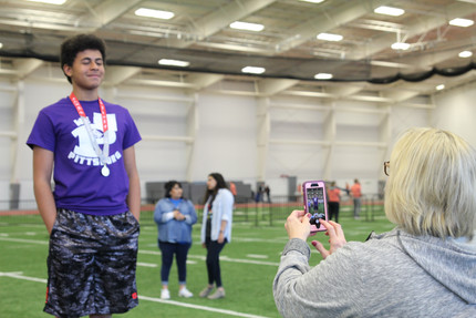 Cindy Frasco, a PHS special educator, snaps a picture of one of her student Special Olympic Athletes. Photo by Nicole-Marie Konopelko.
