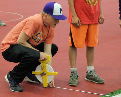 Freshman Cole Jameson measures the distance a Special Olympic athlete's javelin landed. Photo by Nicole-Marie Konopelko.