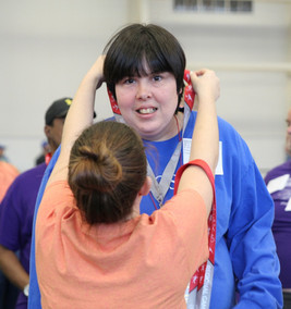 A Special Olympic athlete is awarded her medal. Photo by Nicole-Marie Konopelko.
