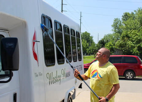 Pittsburg and Parsons's UPS Business Manager Travis Hinspeter washes and cleans Wesley House's food van. This was a part of Hinspeter's volunteer work for the nonprofit agency during United Way of Southwest Missouri and Southeast Kansas's Day of Action on Friday, June 28.