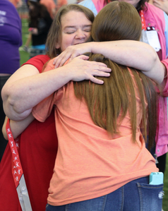 Junior Morgan Noe, a GBL Club Volunteer, embraces a Special Olympic athlete after awarding her with a medal. Photo by Nicole-Marie Konopelko.