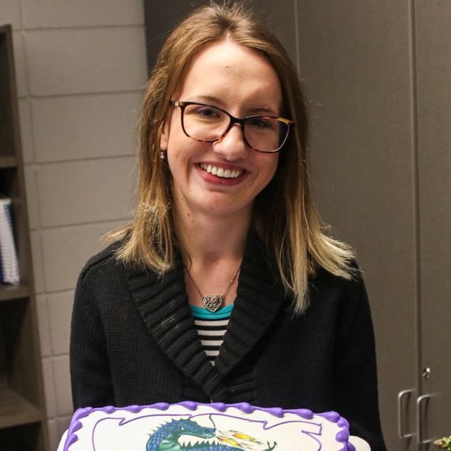 Holding up my congratulatory cake.