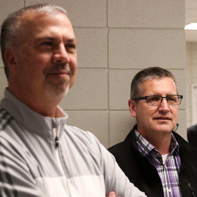 Athletics director Jeff Staley and superintendent Rich Proffitt listen to the presentation.