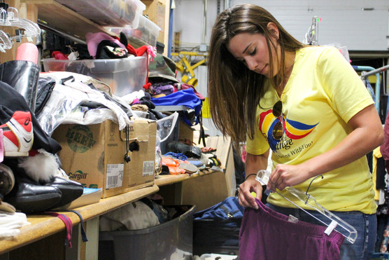 Crawford County Health Department Administrative Assistant Breanna Rhuems hangs up a skirt at the Salvation Army's thrift store in Pittsburg. Rhuems's volunteer work during United Way of Southwest Missouri and Southeast Kansas's Day of Action consisted of hanging up clothes to prepare them for purchase.