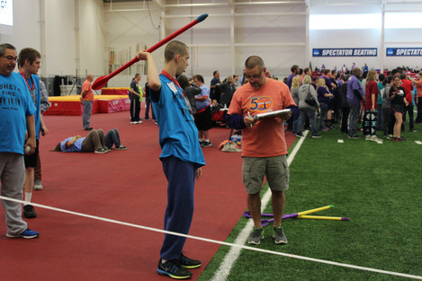 Darin Kelley, health teacher and GBL Club sponsor, instructs an athlete on how to throw his javelin. Kelley helped organize the Special Olympics. Photo by Nicole-Marie Konopelko.